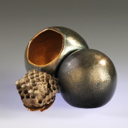 Hand raised copper spheres with transparent enamels